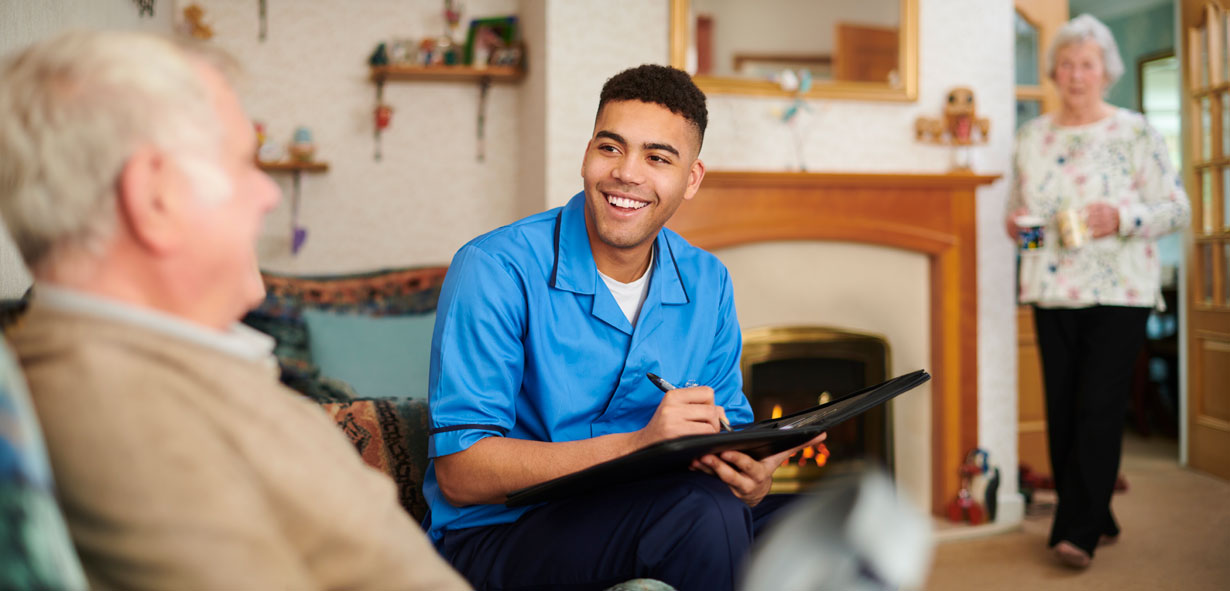 Young male carer making a home visit