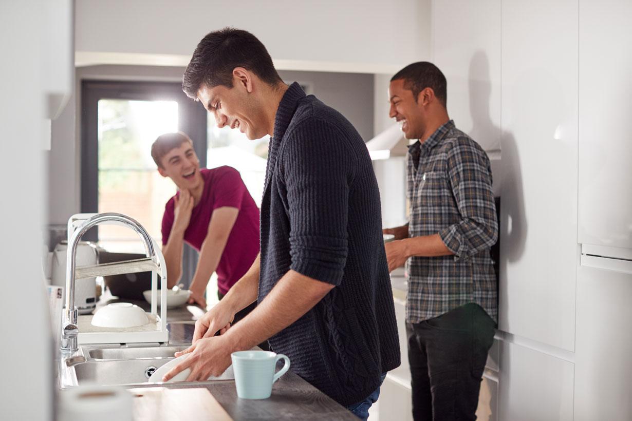 Male flatmates in their kitchen