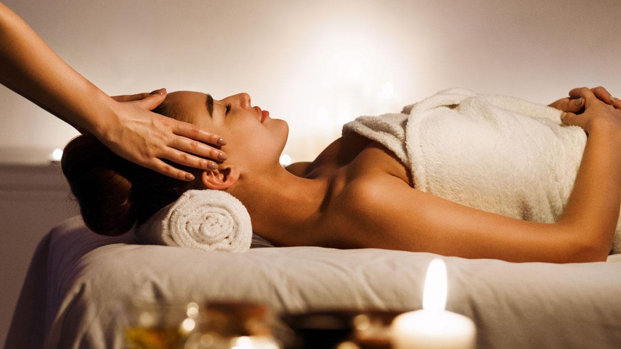 woman receiving a facial massage
