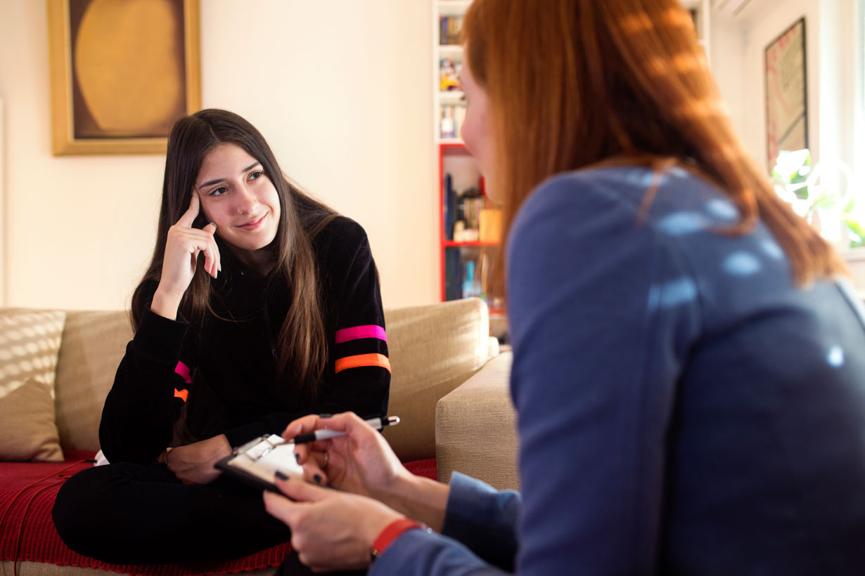 Young woman talking to a counsellor