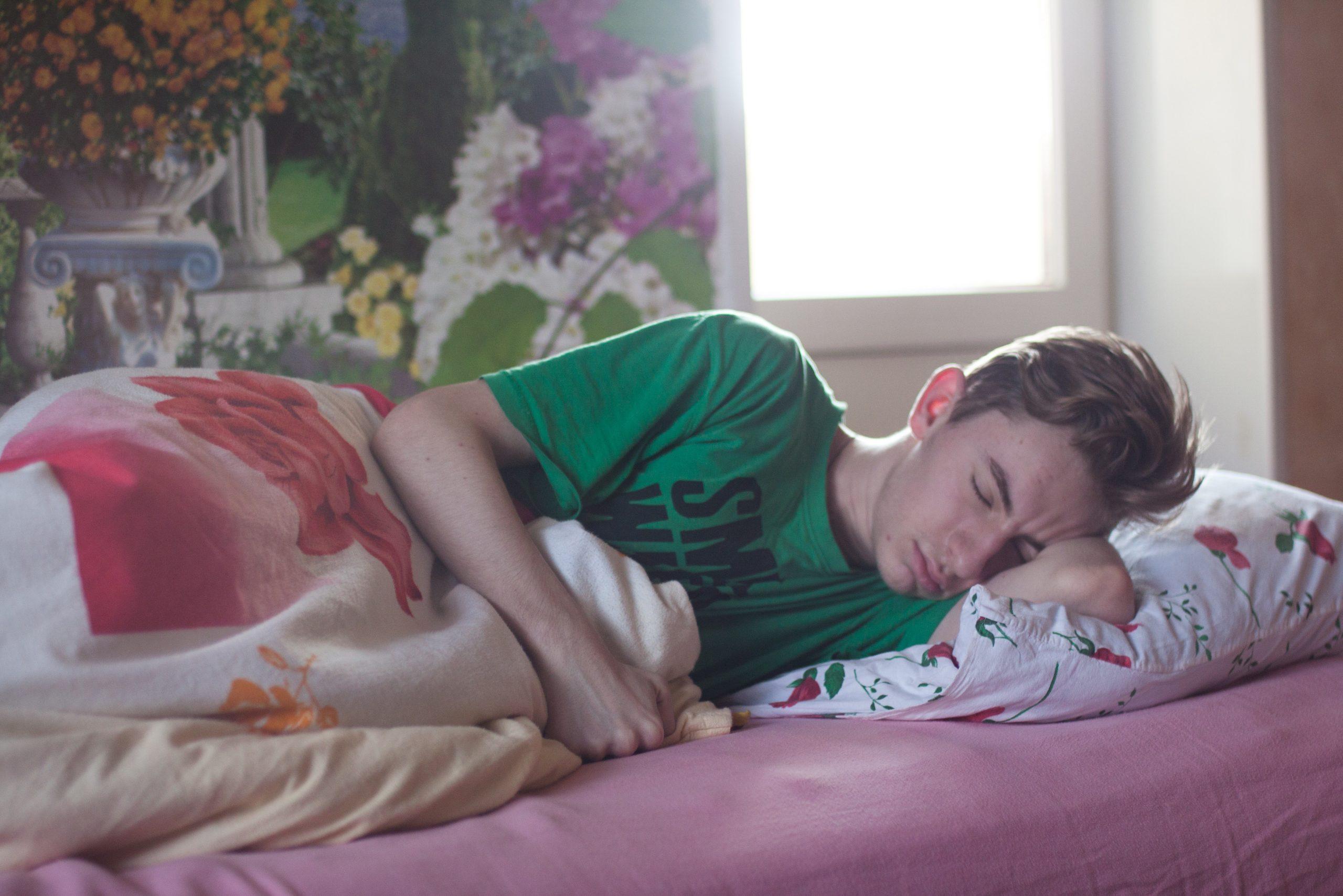Teenager sleeping at home