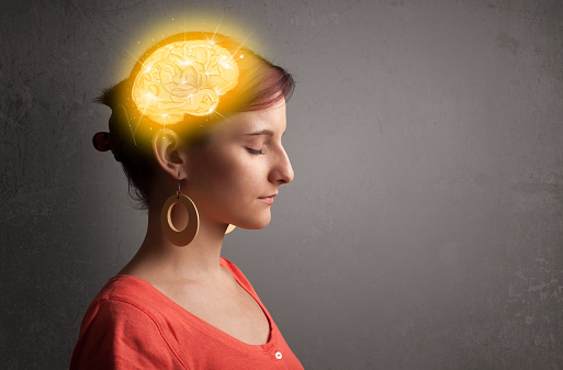 Young woman with a glowing brain illustration