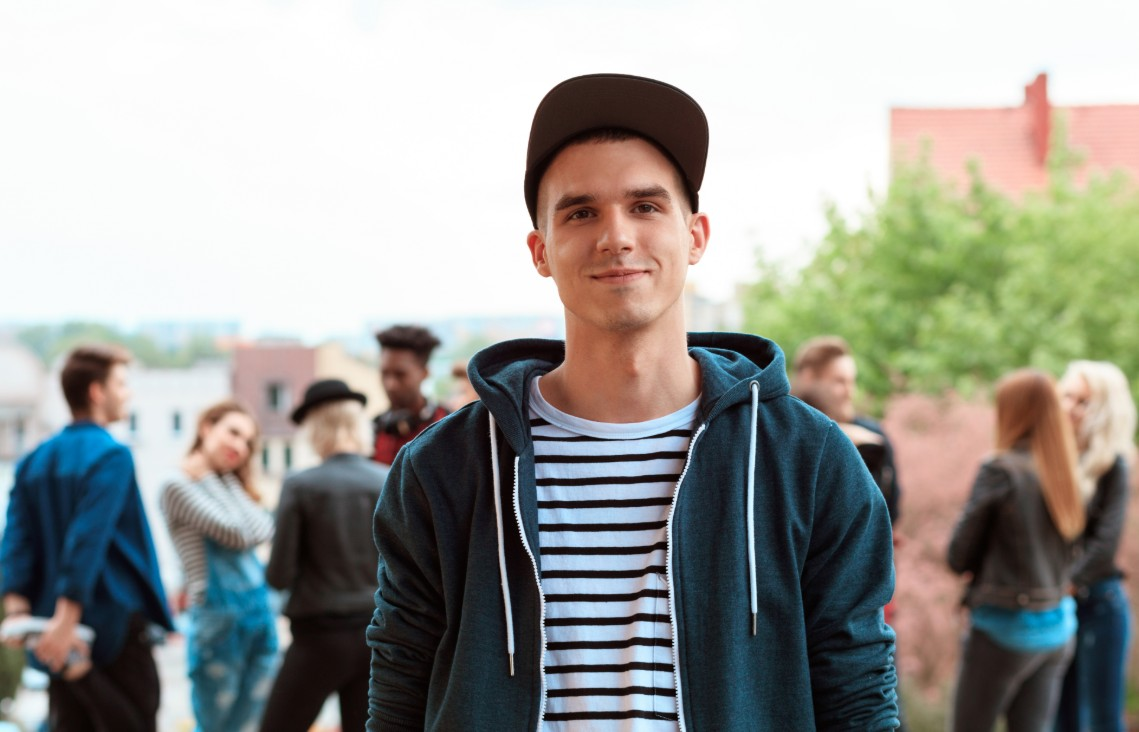 Man in a cap with his friends in the background