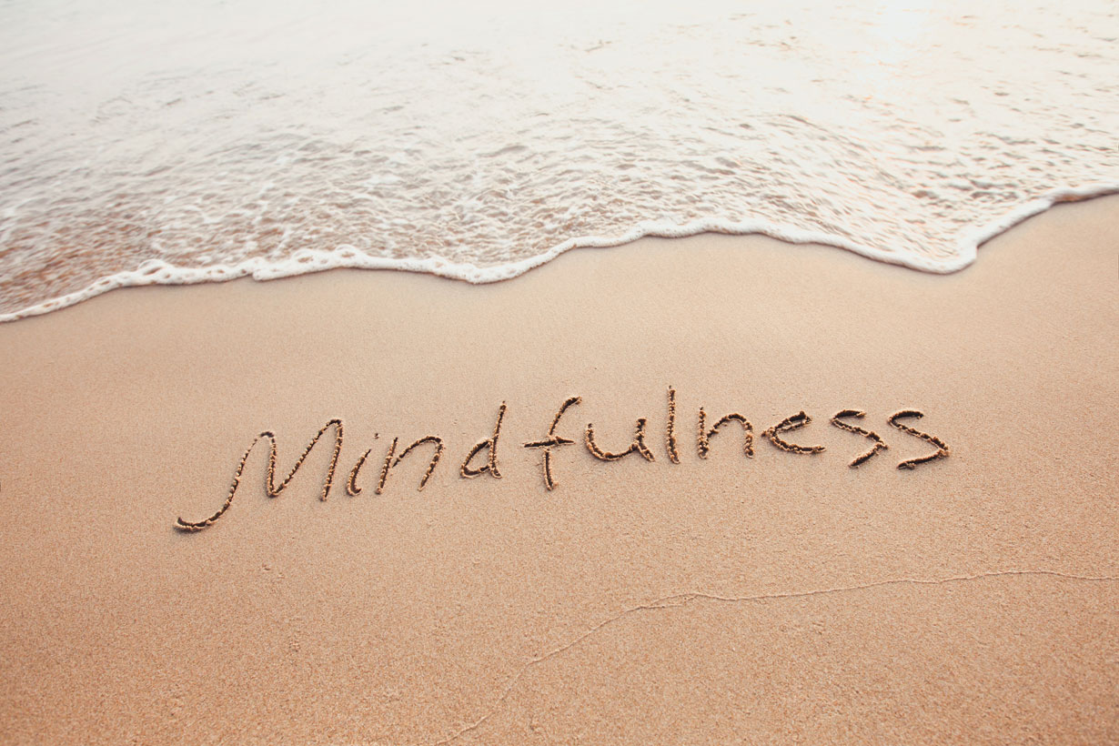 Mindfulness drawn into the sand