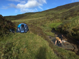 Ally and friend camping in Scotland