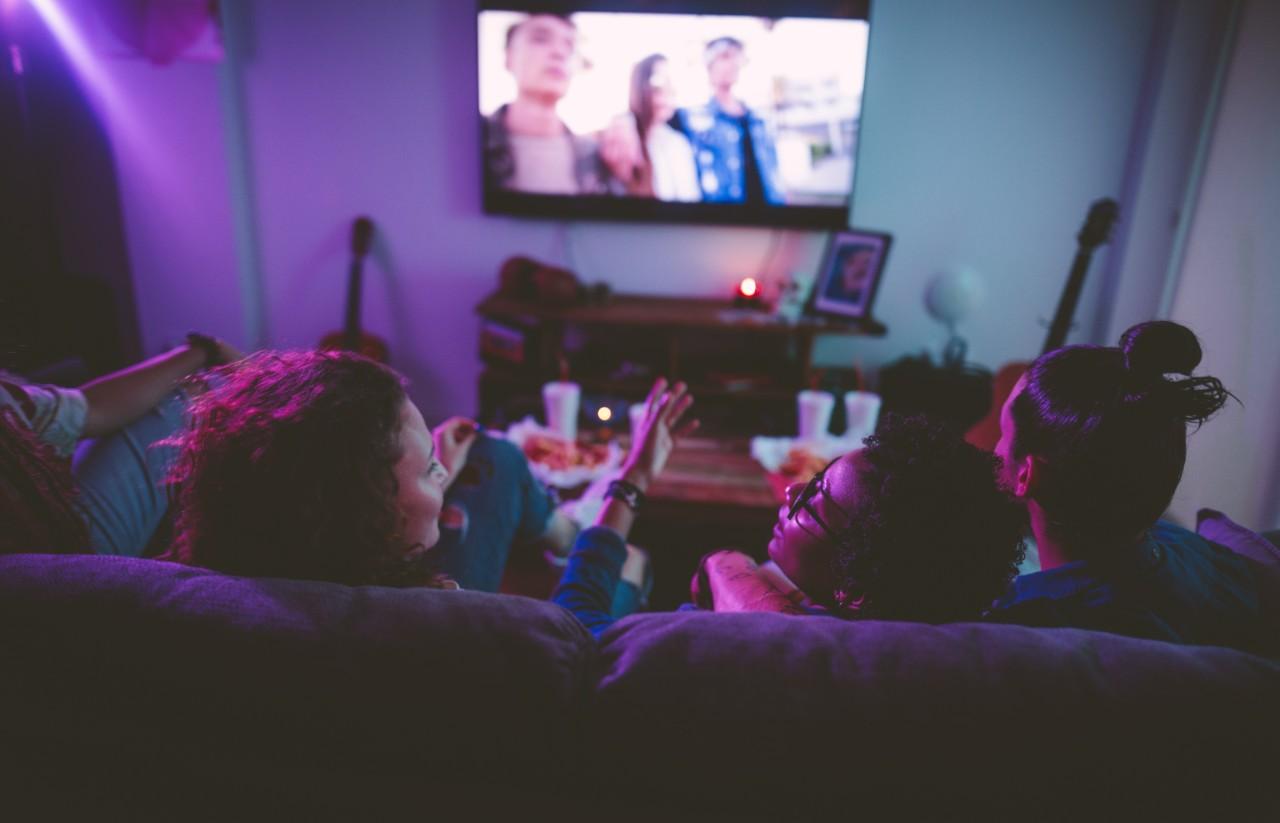 Flatmates watching TV