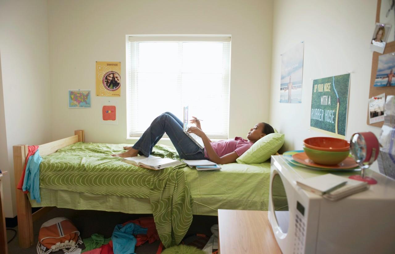 Student in his bedroom
